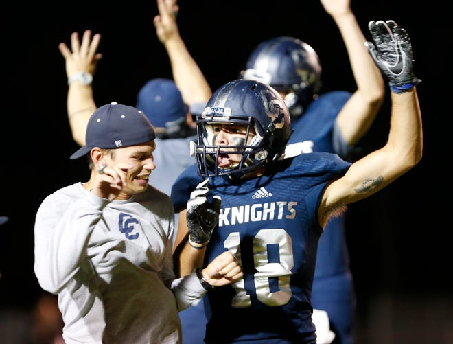Karson Kyhnell and the Central Catholic Knights celebrate after defeating Rensselaer.