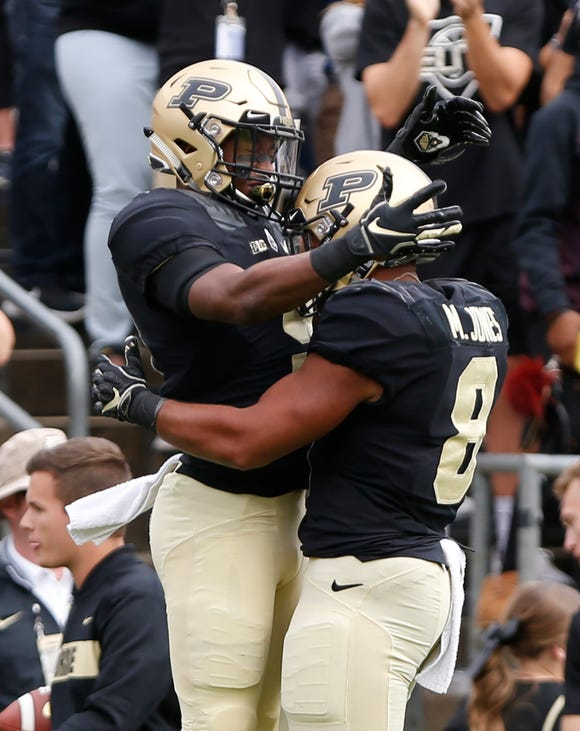 Terry Wright of Purdue celebrates with Markell Jones after his second half touchdown reception against Boston College Saturday, September 22, 2018, in Ross-Ade Stadium. Purdue defeated Boston College 30-13.