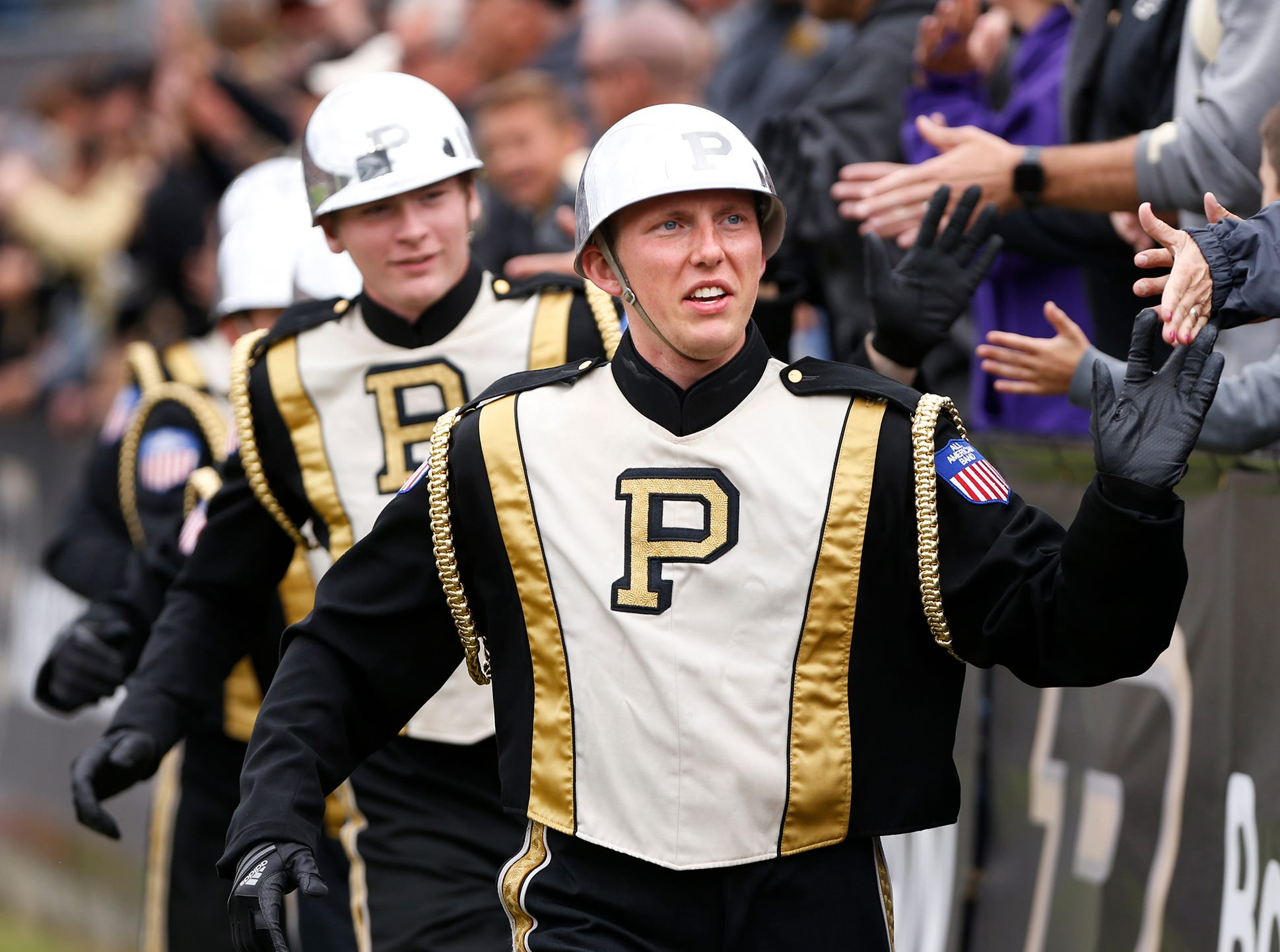 Members of the Drum Crew slap hands with the Purdue faithful as the Boilermakers begin the fourth quarter against Boston College Saturday, September 22, 2018, in Ross-Ade Stadium. Purdue defeated Boston College 30-13.