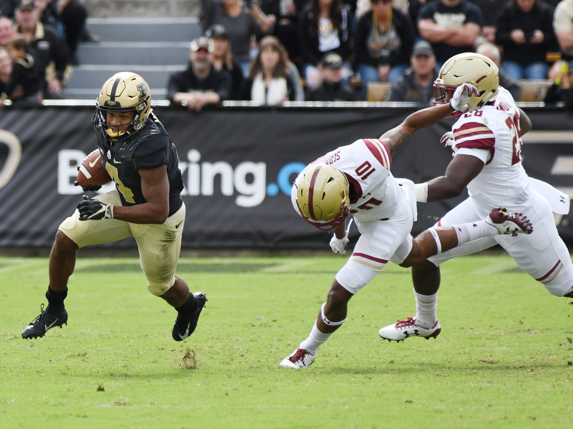 Rondale Moore of Purdue turns the corner on Brandon Sebastian and John Lamot of Boston College on a first half touchdown reception Saturday, September 22, 2018, in Ross-Ade Stadium.