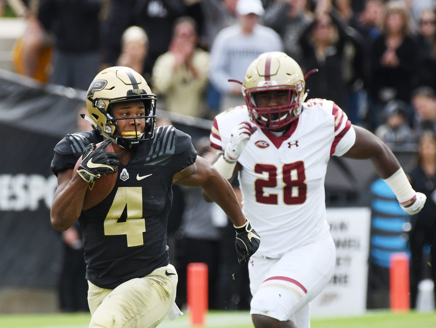 Rondale Moore of Purdue out runs John Lamot of Boston College on a first half touchdown reception Saturday, September 22, 2018, in Ross-Ade Stadium.
