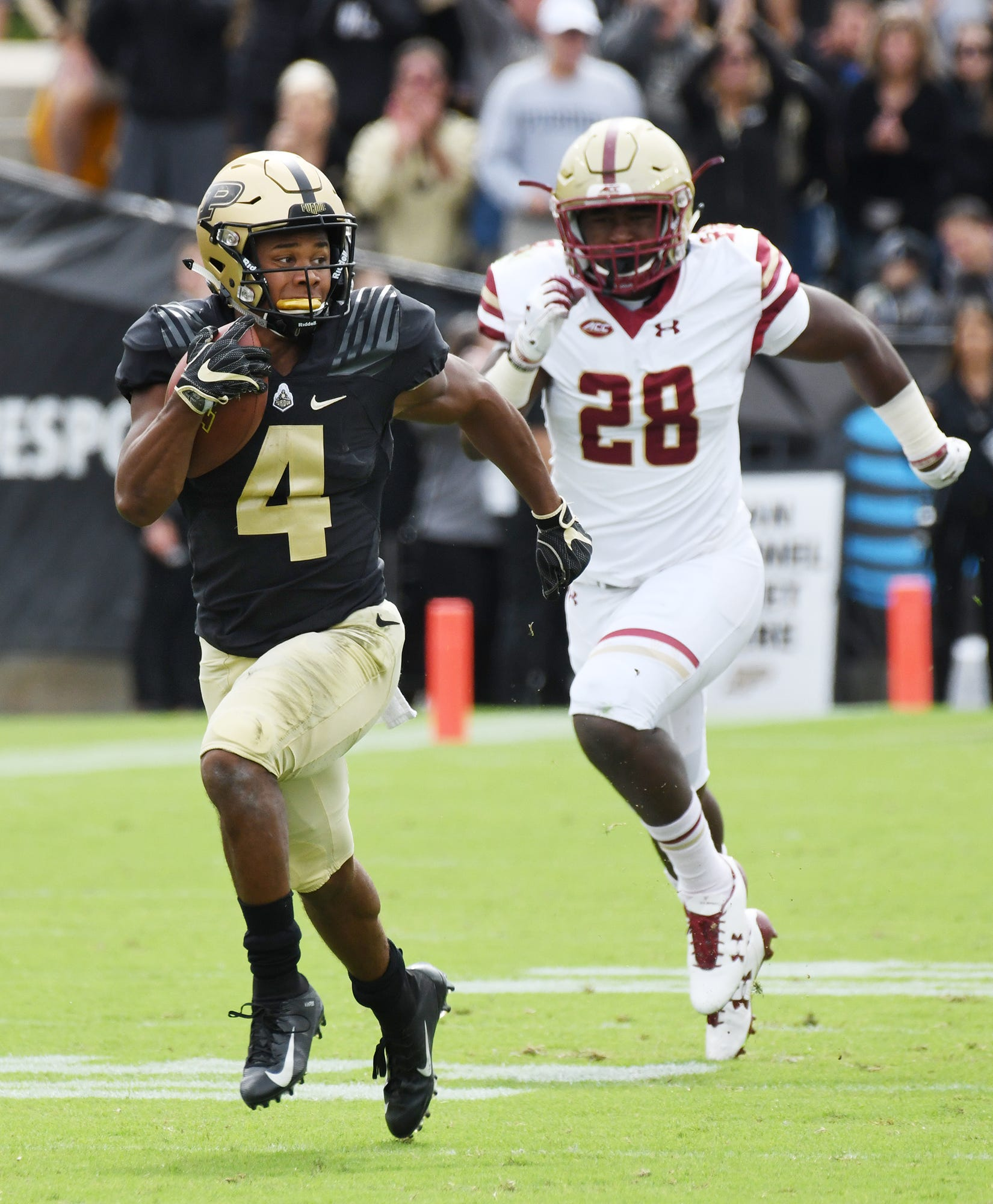 Rondale Moore of Purdue outruns John Lamot of Boston College on a first half touchdown reception.