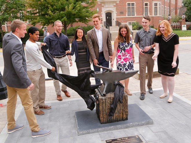 Members of the Iron Key Class of 2018 unveil The Forge sculpture Saturday, September 22, 2018, next to Third Street Towers on the campus of Purdue University. A gift of the Iron Key Class of 2018, The Forge is meant to inspire future generations to become a Boilermaker.