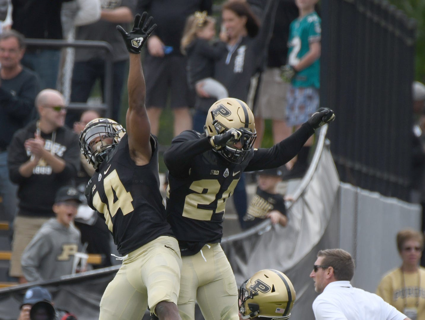 Purdue's Antonio Blackmon, left, celebrates an interception with Tim Cason and Kamal Hardy in Purdue's 30-13 win in West Lafayette on Saturday September 22, 2018.