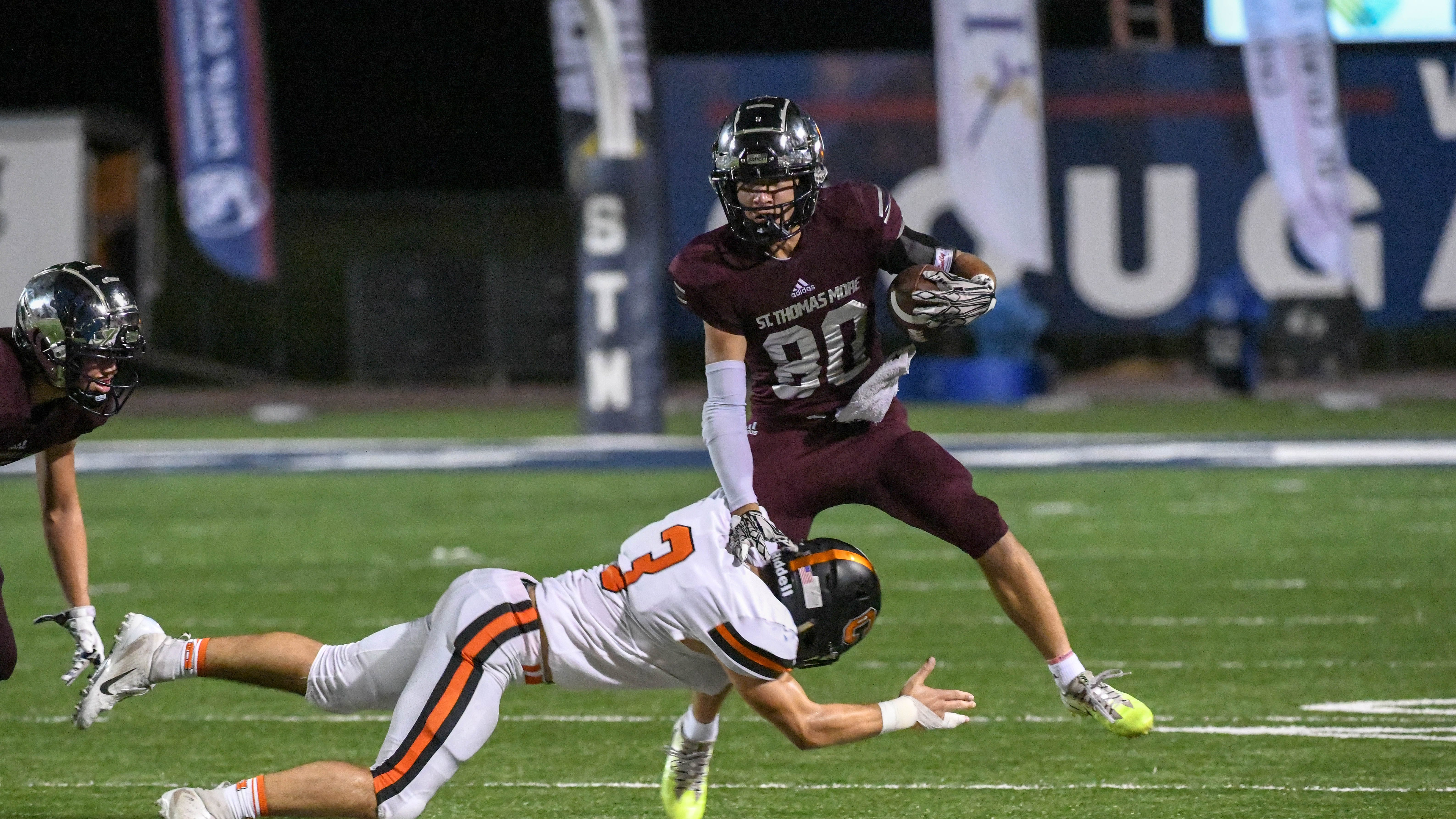 St. Thomas More wide receiver Grant Arceneaux collected 12 receptions for 225 yards and four touchdowns in the Cougars' 52-43 loss to Catholic High on Friday.