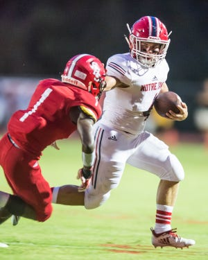 Gabe Menard (4) for the Pioneers tries to get to the outside as Notre Dame travels to Catholic-New Iberia to play in a rematch of last year's state championship game on Friday night, September 21, 2018.
