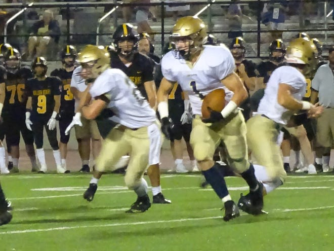 Lancaster running back Mason Hamilton runs the ball Friday against Upper Arlington. The Gales had a thrilling come-from-behind 28-28 victory.