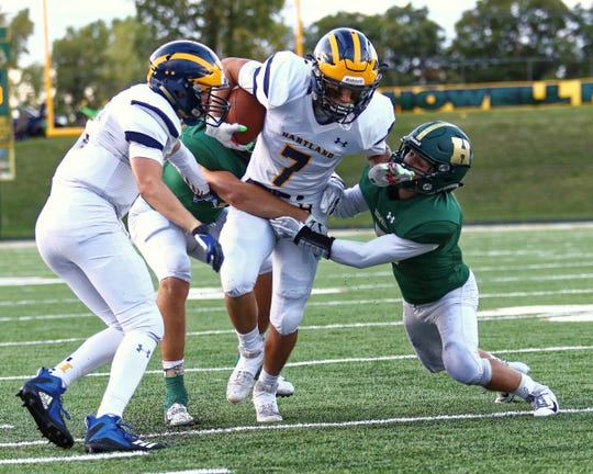 Hartland's Reece Potter (7) ran 19 times for 135 yards and a touchdown in a 42-14 loss at Howell on Friday, Sept. 21, 2018.