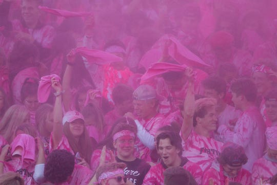 The student section of the Bulldog side of the field was filled with pink, and pink powder filled the air briefly in the first quarter of the game Friday, Sept. 21, 2018 to raise money in the fight against cancer.