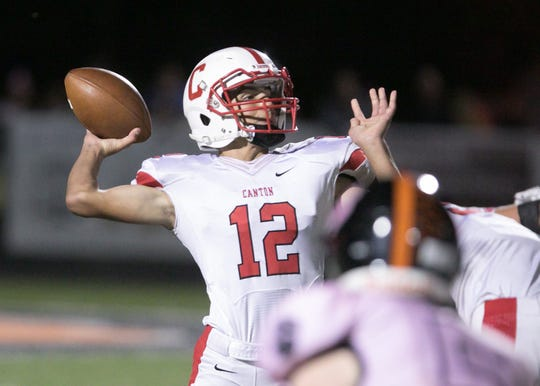 Canton quarterback Ben Stesiak finds his target in Noah VanBerkel in the fourth quarter of the game at Brighton Friday, Sept. 21, 2018.