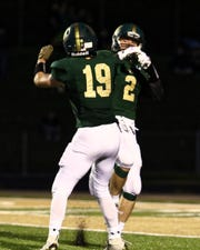 Howell's Bo Niehaus (2) celebrates his touchdown before halftime with teammate Christian Nichols during a 42-14 victory over Hartland on Friday, Sept. 21, 2018.