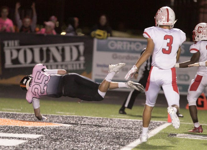 Brighton quarterback Will Jontz dives into the endzone in sudden death overtime in the game against Canton Friday, Sept. 21, 2018, winning the game for the Bulldogs.