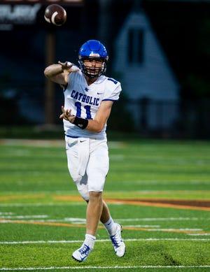 Lexington Catholic QB Beau Allen (11) tossed a pass against the Colts' defense. Sept. 21, 2018
