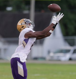 Male's Izayah Cummings looks the ball in for the catch.  Sept. 21, 2018