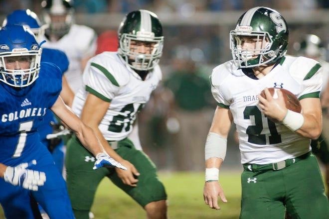 South Oldham running back Keaton Martin turns the corner as Oldham County hosts South Oldham in the cross-county high school football rivalry.September 21, 2018