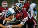 The highlights from Friday night's high school football game between No. 2 Lansing Catholic and No. 4 Portland.