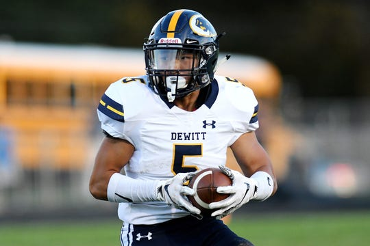 DeWitt's Malakai Matthews runs with the ball during the first quarter on Friday, Sept. 21, 2018, in East Lansing.