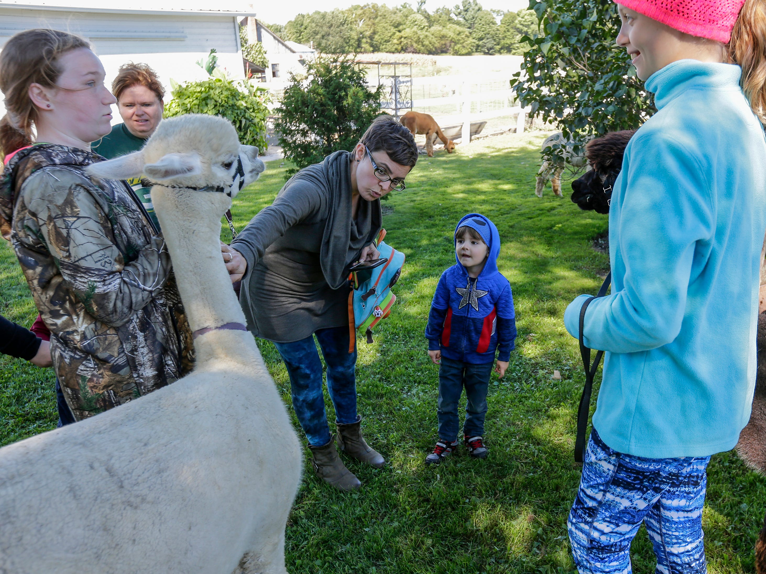 Erica Haven, of Port Washington, shows her son Everett, 3, how to pet an alpaca during National Alpaca Days at LondonDairy Alpaca Ranch Saturday, September 22, 2018, in Two Rivers, Wis. Josh Clark/USA TODAY NETWORK-Wisconsin