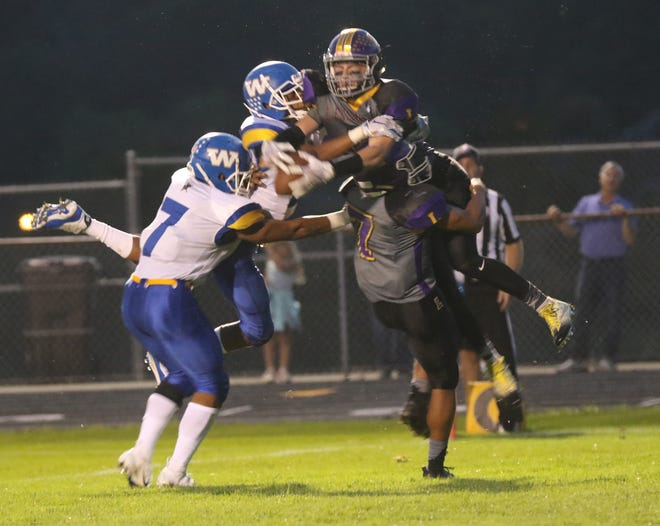 Lexington's Josh Aiello attempts a catch while playing a home game against Wooster earlier in the season.
