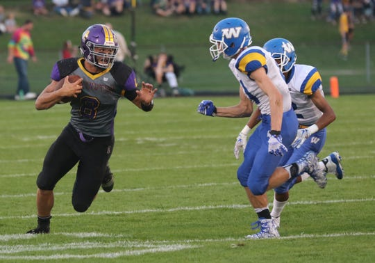 Lexington's Cade Stover runs with the ball while playing a home game against Wooster earlier in the season.