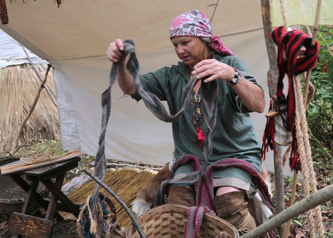Jan Lowe demonstrates how to make dye and weave fabrics during the Greentown gathering south of Lucas on Saturday.