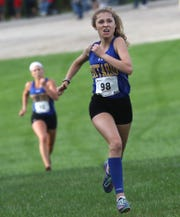 Ontario's Ellie Maurer competes during the Bill Brown XC Invite at Ontario Marshall Park on Saturday.