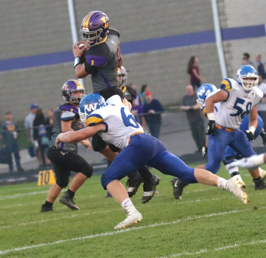 Lexington's Cade Stover is tackled while playing a home game against Wooster on Friday.
