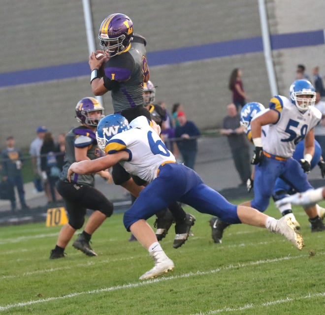 Lexington's Cade Stover is tackled while playing a home game against Wooster earlier in the season.