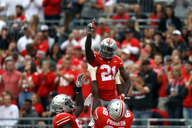 Ohio State H-back Parris Campbell celebrates his touchdown with linemen Isaiah Prince and Malcolm Pridgeon in Saturday's rout of Tulane.
