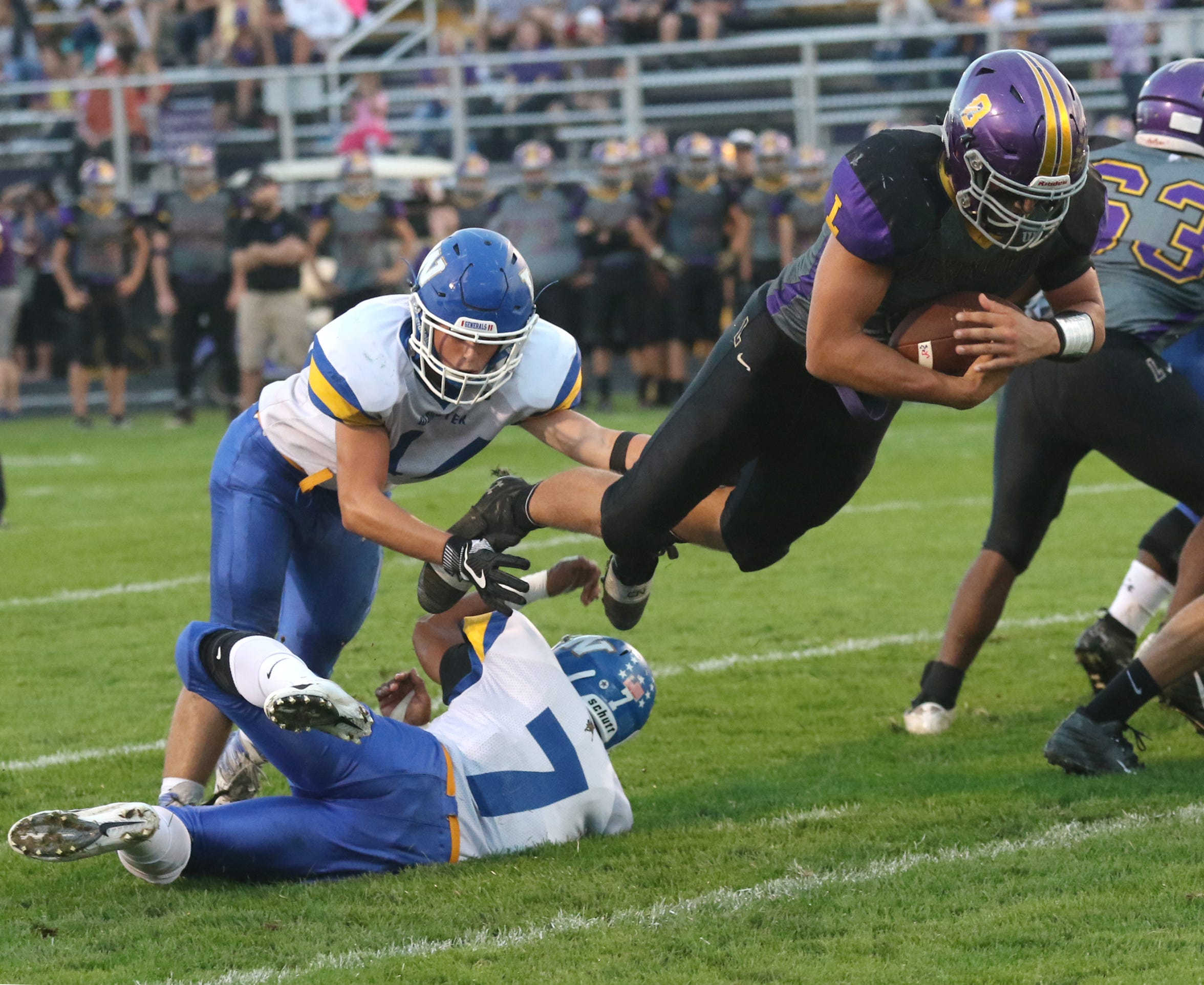 Lexington's Cade Stover slips through the defense to make a touchdown while playing a home game against Wooster earlier in the season.