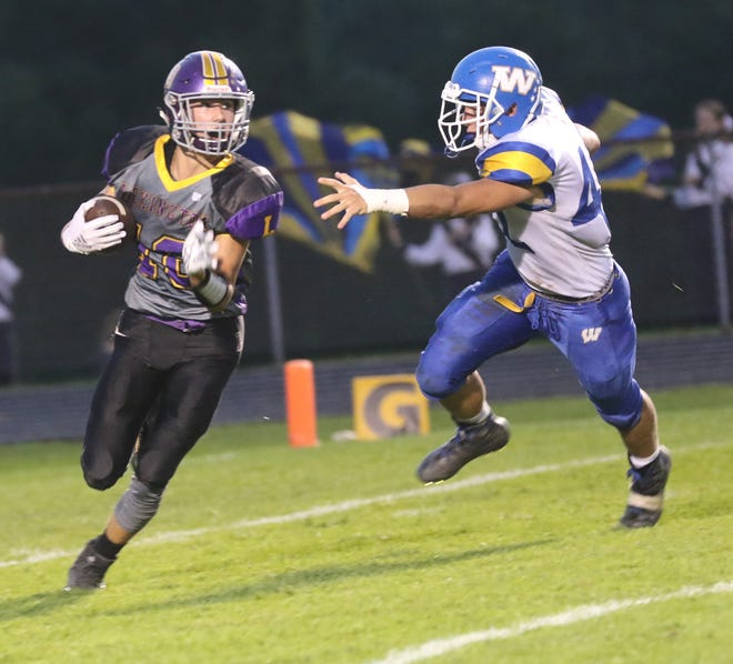 Lexington's Alex Green runs with the ball while playing a home game against Wooster last week.