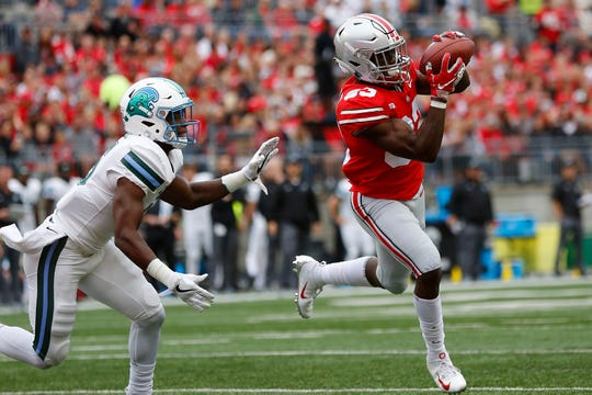 Ohio State wide receiver Terry McLaurin catches a touchdown pass in front of Tulane safety Sean Harper.