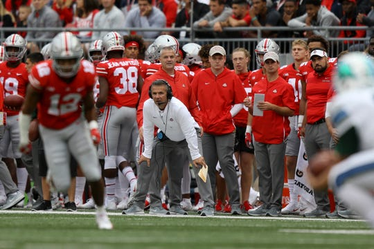 His three-game suspension over, Ohio State coach Urban Meyer was on the sidelines for the first time this season in Saturday's game with Tulsa.