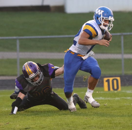 Lexington's Tyler Donley drags down a ballcarrier during Friday's Ohio Cardinal Conference game with Wooster.