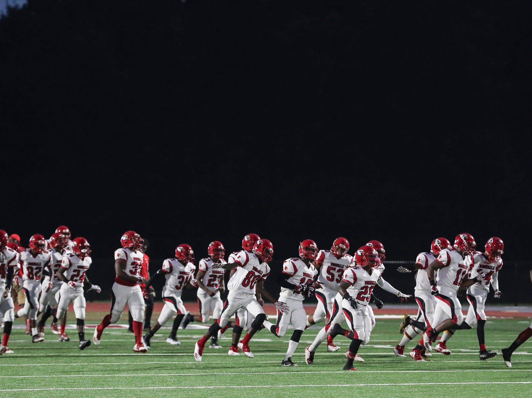 September 21 2018 - Wooddale's team runs onto the field before the start of Friday night's game at Collierville High School.