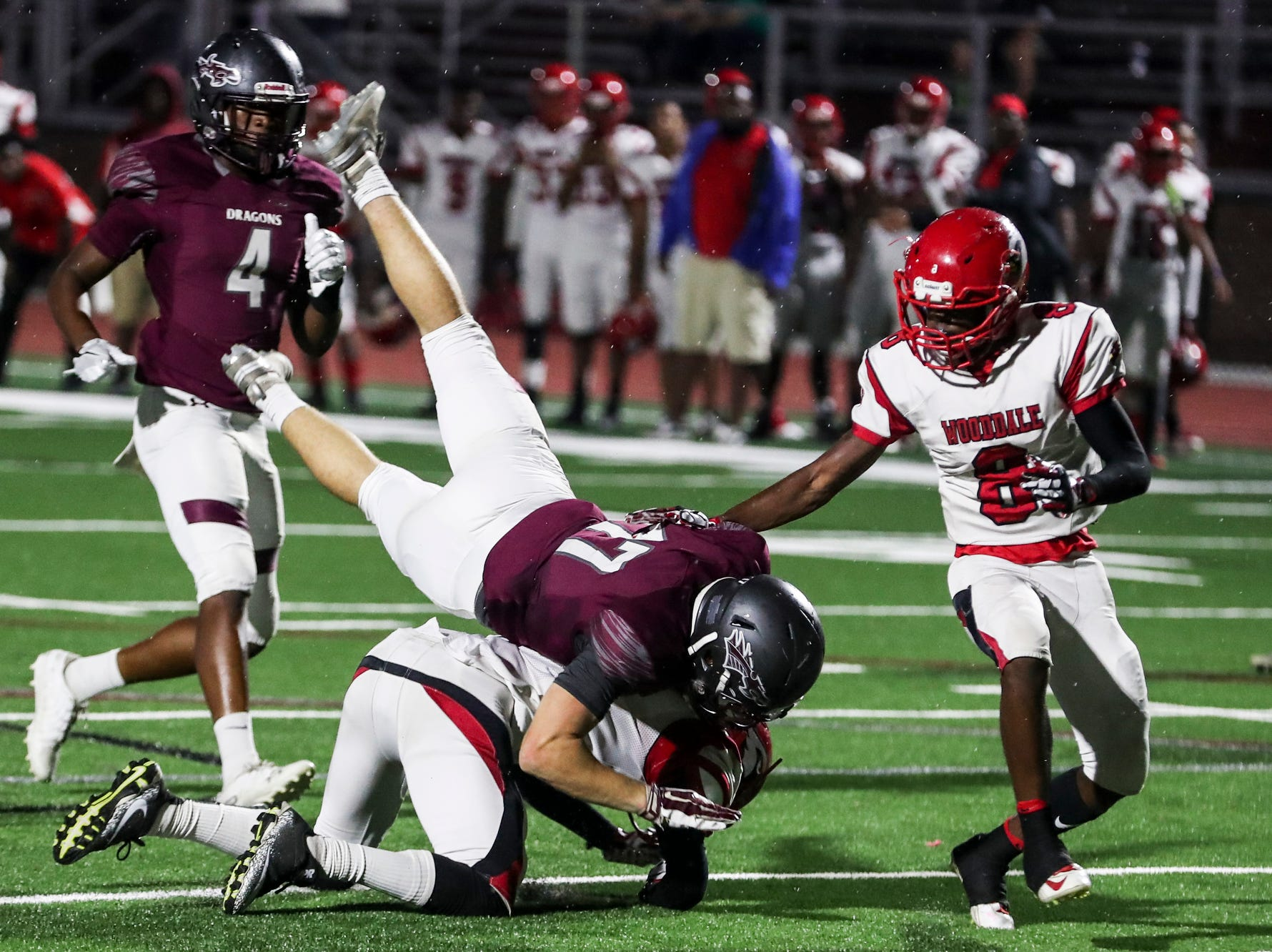 September 21 2018 - Collierville's Cade Cupp is tripped up while running during Friday night's game versus Wooddale at Collierville High School.
