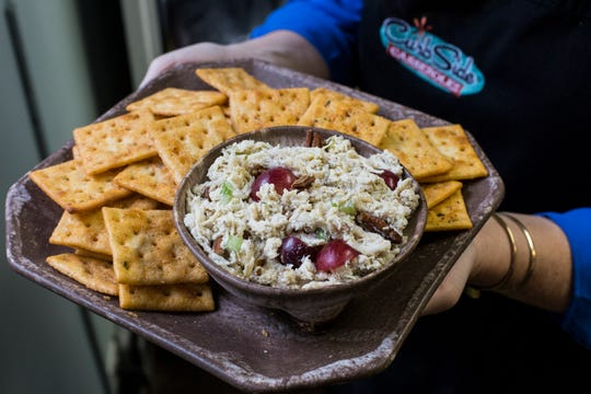Curb Side Casseroles adds grapes, toasted pecans, and their homemade sweet pickles to their signature chicken salad.