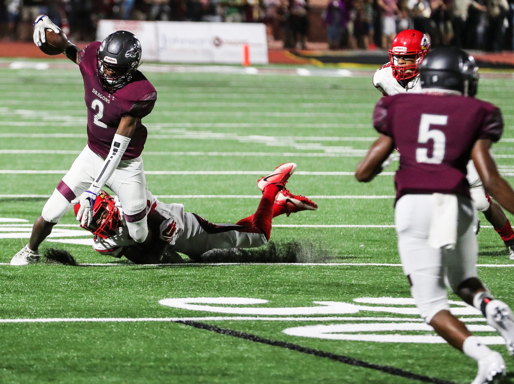 September 21 2018 - Collierville's Jordan Henderson runs with the ball during Friday night's game versus Wooddale at Collierville High School.
