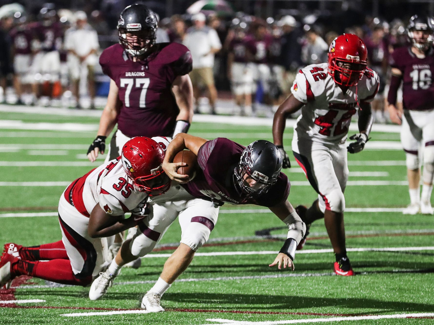 September 21 2018 - Collierville's Peyton Murphy is brought down by Wooddale defense during Friday night's game versus Wooddale at Collierville High School.