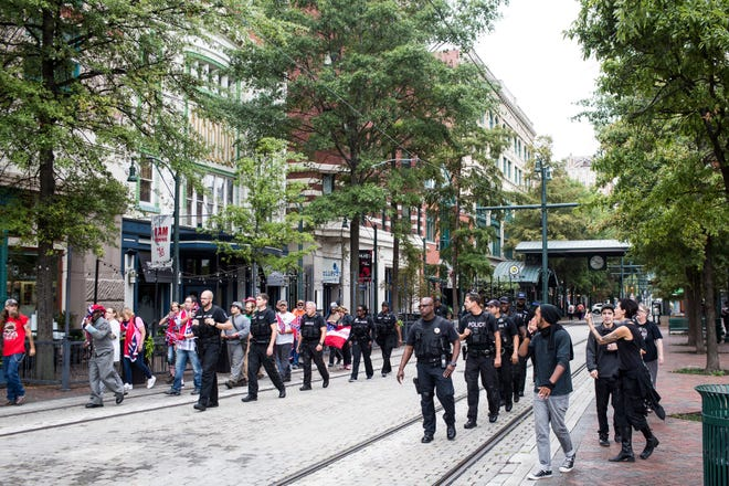 September 22 2018 - Memphis Police separate counter-protesters from members of the Confederate 901 group as they walked South on Main Street. The Confederate 901 group is upset over the July 28 removal of additional Confederate memorabilia from a Memphis park in addition to the removal of statues of Confederate President Jefferson Davis and Gen. Nathan Bedford Forrest.