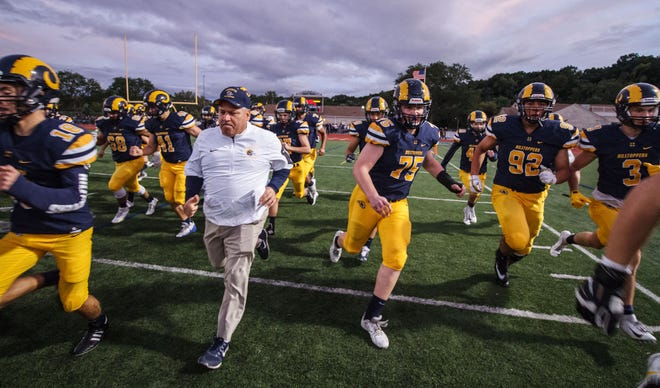 Marquette head coach Jeff Mazurczak takes the field with his team prior to the game at home against Brookfield Central on Friday, Sept. 21, 2018.
