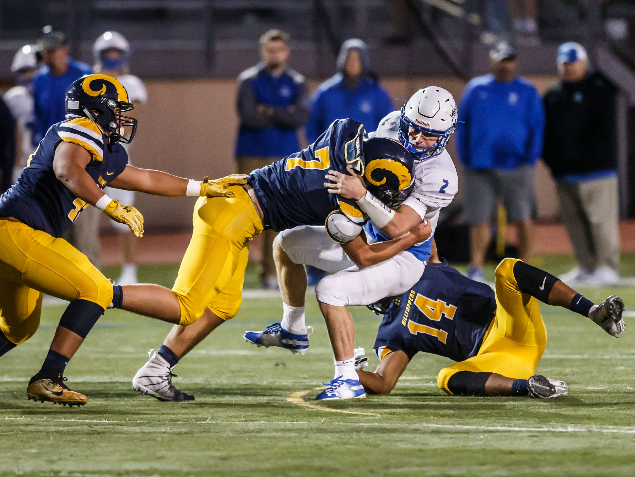 Marquette's John O'Brien (7) and Riley Nowakowski (14) catch Brookfield Central quarterback Drew Leszczynski (2) in the backfield during the game at home on Friday, Sept. 21, 2018.