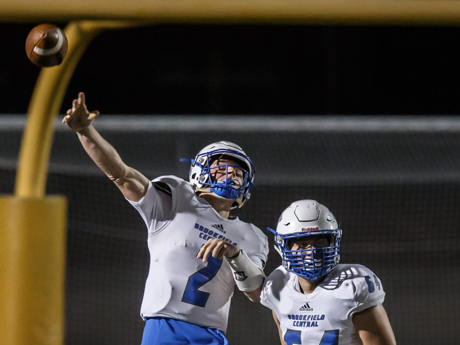 Brookfield Central quarterback Drew Leszczynski (2) sends a bomb downfield late in the first half of the game against Marquette at Hart Park on Friday, Sept. 21, 2018. The pass fell incomplete.