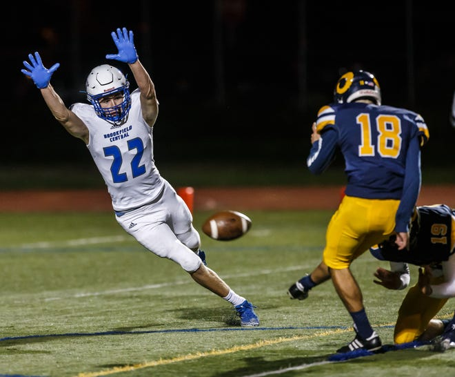 Brookfield Central defensive back Joey Cleary  attempts to block a PAT during the game against Marquette at Hart Park.