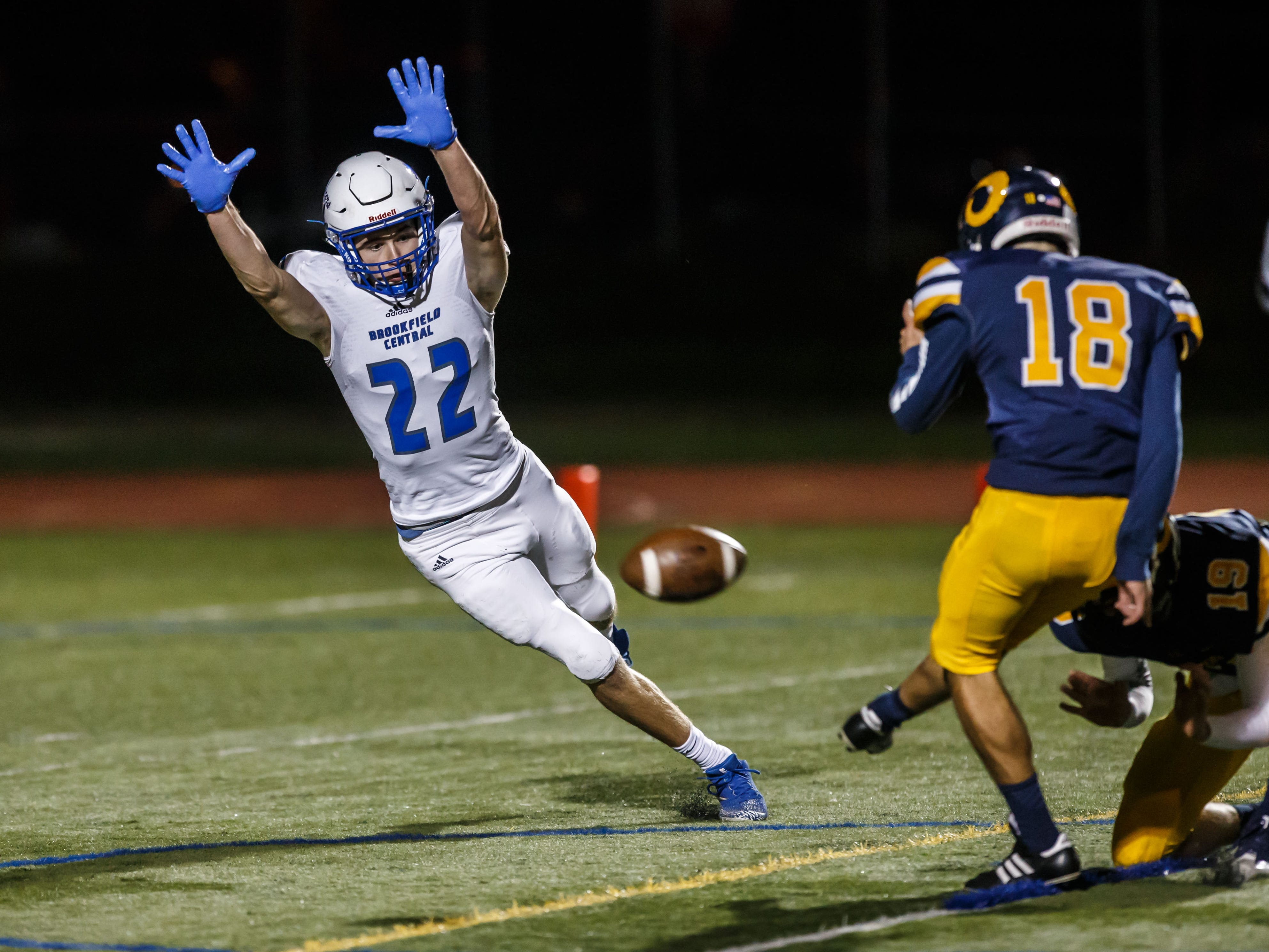 Brookfield Central defensive back Joey Cleary (22) attempts to block a PAT during the game against Marquette at Hart Park on Friday, Sept. 21, 2018.