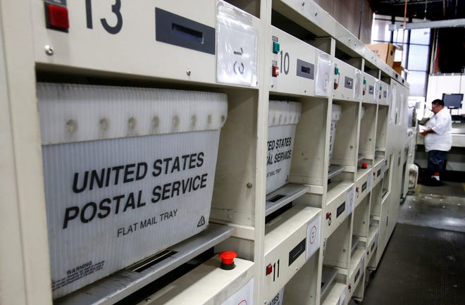 """Long delays for mail and packages sent through the U.S. Postal Service are tied to employee shortages and a """"historic"""" volume of mail, the Postal Service and employees said. A partially constructed mail facility in Oak Creek has become a local hub for the packages, with employees working mandatory 12-hour shifts seven days a week."""