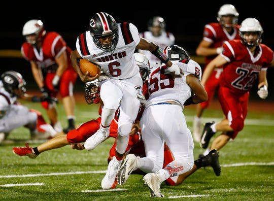 Boonton's Corey Dempster gains yardage vs. Whippany Park during their SFC American Blue Friday night football game. September 21, 2018, Whippany, NJ