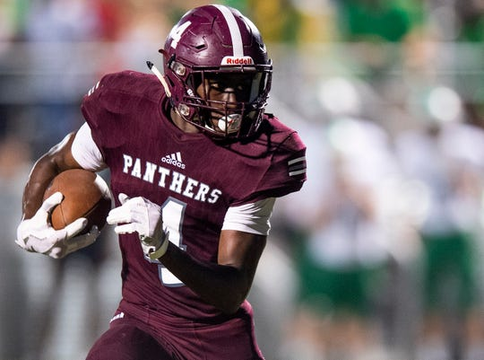 Elmore County's Deundre Patrick breaks free for a first quarter touchdown against Holtville in Eclectic, Ala., on Friday September 21, 2018.