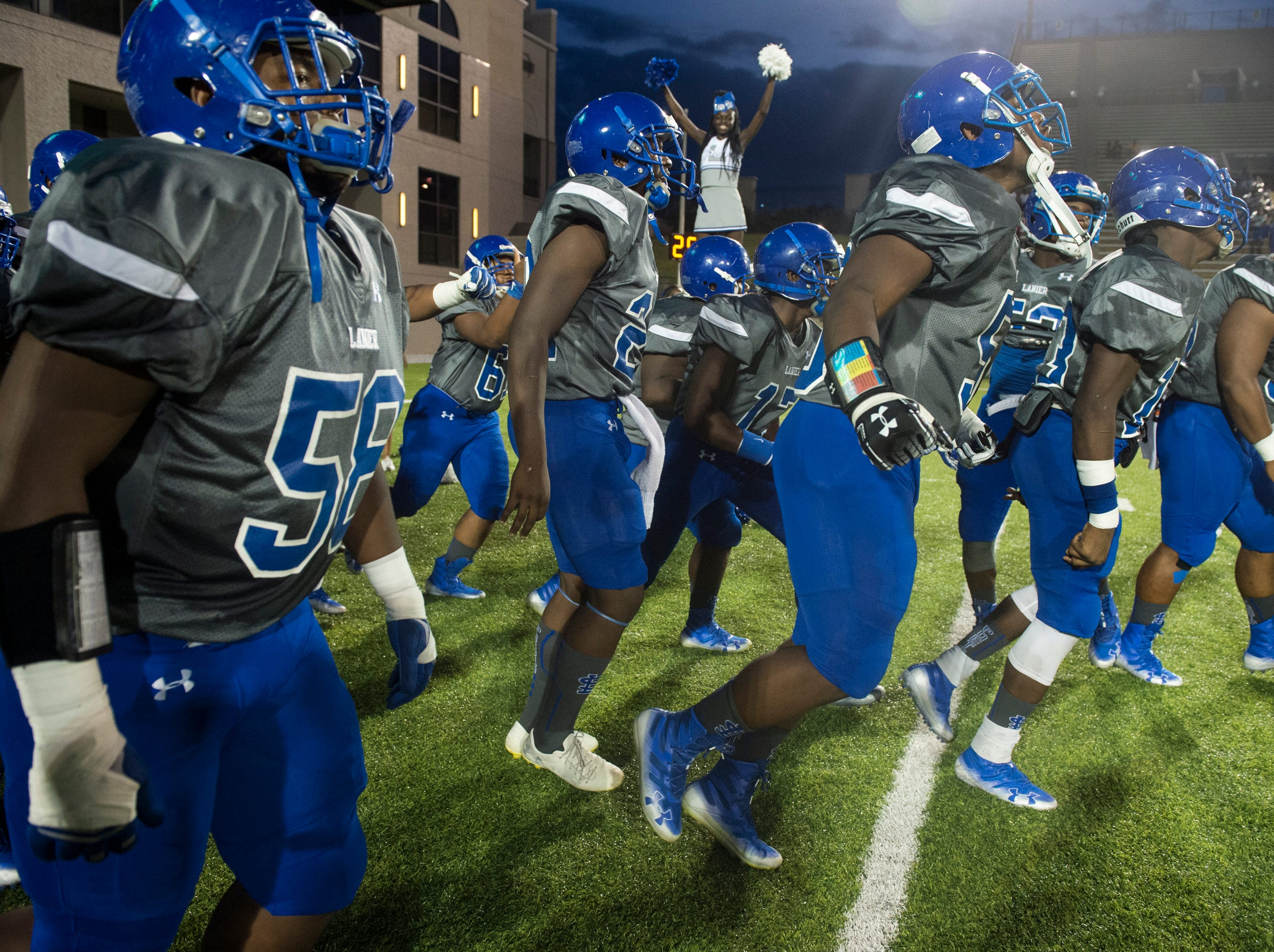 Lanier players take the field as they are introduced at Cramton Bowl in Montgomery, Ala., on Friday, Sept. 21, 2018. Lanier leads Park Crossing 14-7 at halftime.