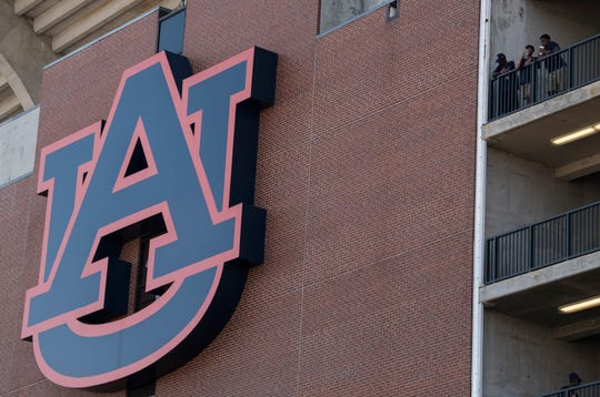 The Auburn University logo hangs outside Jordan-Hare Stadium.